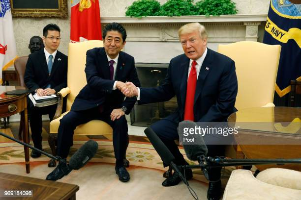US President Donald Trump meets with Japanese Prime Minister Shinzo Abe in the Oval Office of the White House on June 7 2018 in Washington DC The two...