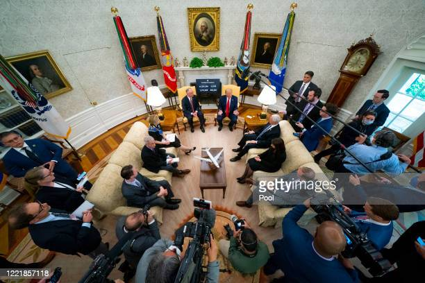 President Donald Trump meets with Louisiana Gov. Jon Bel Edwards in the Oval Office of the White House April 29, 2020 in Washington, DC. During the...