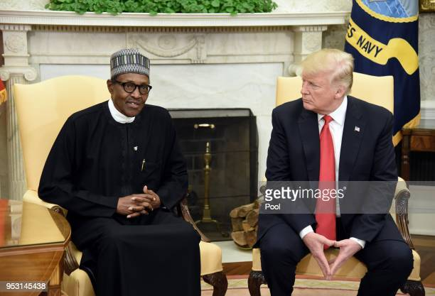 US President Donald Trump meets with Nigerian President Muhammadu Buhari in the Oval Office of the White House on April 30 2018 in Washington DC The...