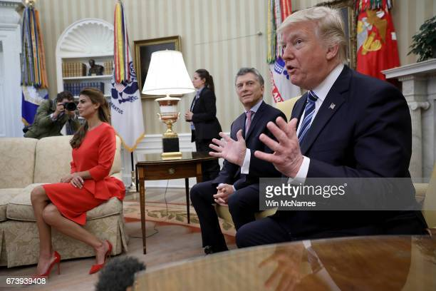 S President Donald Trump meets with President Mauricio Macri of Argentina and the first lady of Argentina Juliana Awada in the Oval Office of the...