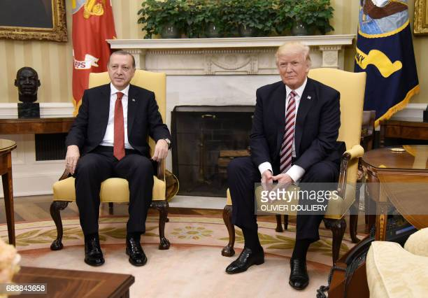 US President Donald Trump meets with President Recep Tayyip Erdogan of Turkey in the Oval Office of the White House in Washington DC on May 16 2017 /...