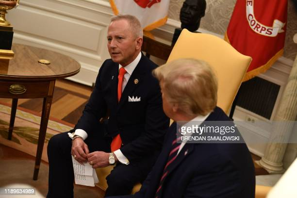 US President Donald Trump meets with Rep Jeff Van Drew in the Oval Office at the White House on December 19 2019 in WashingtonDC Trump brought Van...