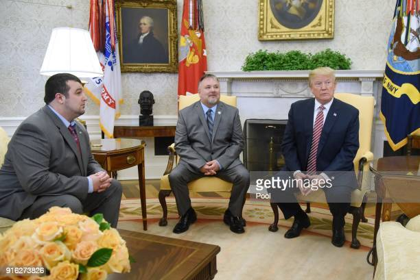 US President Donald Trump meets with Shane Bouvet and Don Bouvet who has been battling cancer in the Oval Office of the White House February 9 2018...