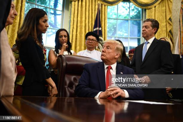 US President Donald Trump meets with survivors of religious persecution on July 17 in the Oval Office of the White House in Washington DC
