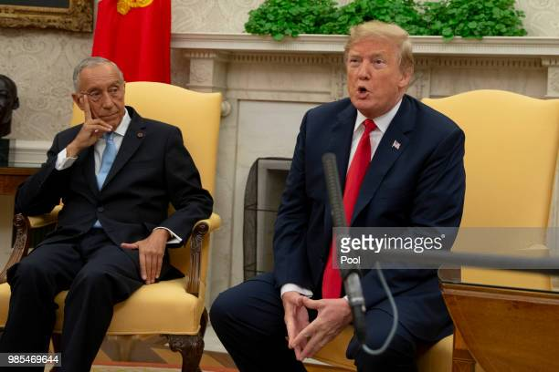 US President Donald Trump meets with The President of Portugal Marcelo Rebelo de Sousa in the Oval Office at the White House on June 27 2018 in...