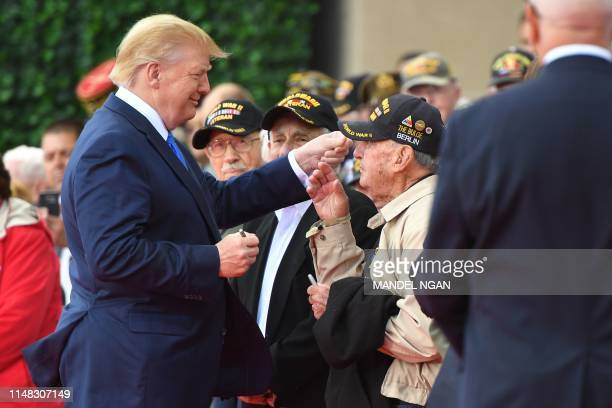 US President Donald Trump meets with WWII veterans during a FrenchUS ceremony at the Normandy American Cemetery and Memorial in CollevillesurMer...