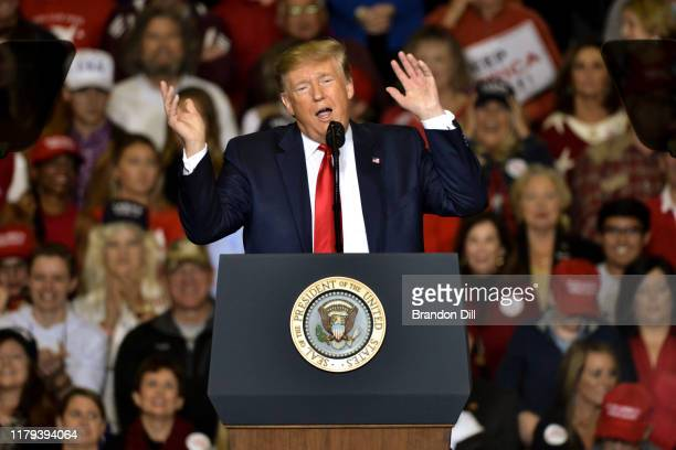 President Donald Trump mocks Beto O'Rourke during a Keep America Great campaign rally at BancorpSouth Arena on November 1 2019 in Tupelo Mississippi...