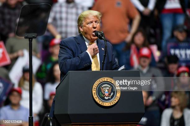 President Donald Trump mocks choking while describing Democratic Presidential candidate Mike Bloomberg's debate performance during a Keep America...