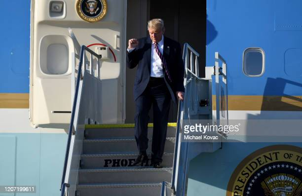 S President Donald Trump motions to supporters as he arrives on Air Force One at LAX Airport on February 18 2020 in Los Angeles California