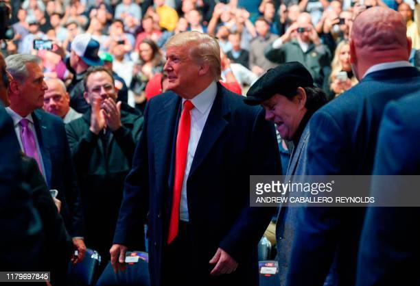 US President Donald Trump next to Panamanian boxer Roberto Duran arrives to attend the Ultimate Fighting Championship at Madison Square Garden in New...