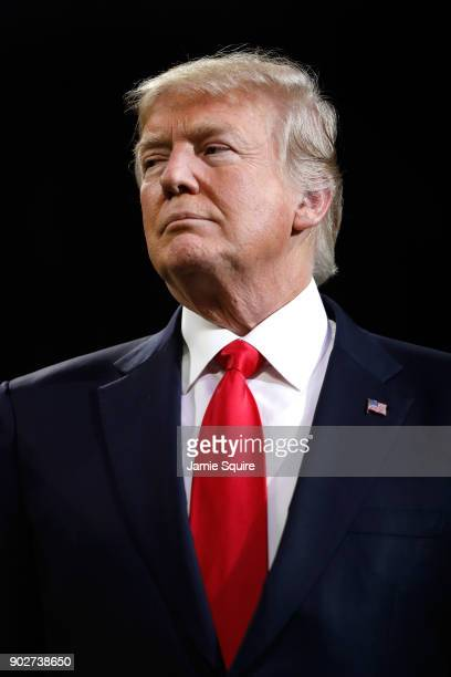 President Donald Trump on field during the national anthem prior to the CFP National Championship presented by AT&T between the Georgia Bulldogs and...