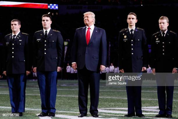 S President Donald Trump on field during the national anthem prior to the CFP National Championship presented by ATT between the Georgia Bulldogs and...