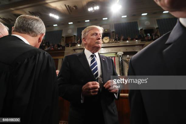 US President Donald Trump on his way out after delivering his first address to a joint session of Congress on February 28 2017 in the House chamber...