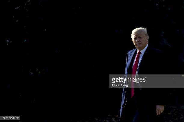 US President Donald Trump on the South Lawn of the White House before boarding Marine One in Washington DC US on Thursday Dec 21 2017 Trump is...