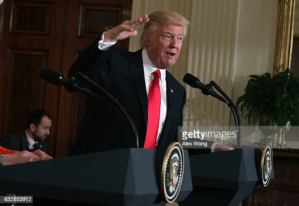 S President Donald Trump participates in a joint press conference with British Prime Minister Theresa May in the East Room of the White House January...