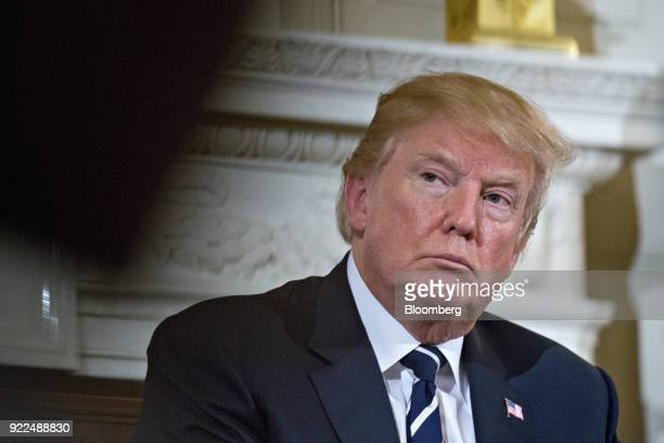 US President Donald Trump participates in a listening session on gun violence with high school students teachers and parents in the State Dining Room...