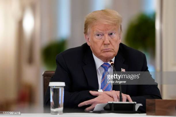 S President Donald Trump participates in a meeting of the American Workforce Policy Advisory Board in the EastRoom of the White House on June 26...