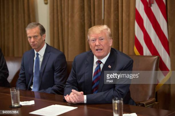 US President Donald Trump participates in a meeting on trade with governors and members of Congress at the White House on April 12 2018 in Washington...