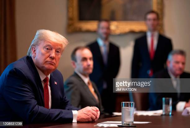 US President Donald Trump participates in a meeting with Supply Chain Distributors to discuss the response to COVID19 at the White House in...