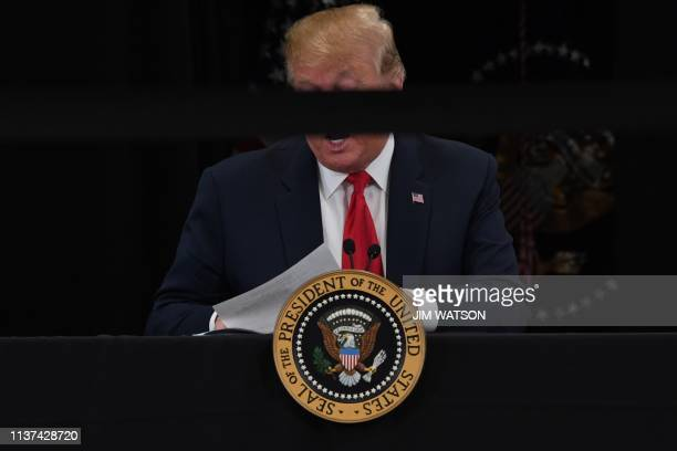 President Donald Trump participates in a roundtable discussion on the economy and tax reform on April 15 at Nuss Truck and Equipment in Burnsville...