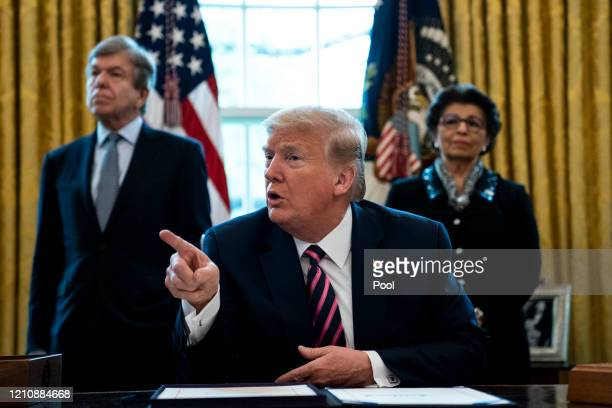 S President Donald Trump participates in a signing ceremony for HR266 the Paycheck Protection Program and Health Care Enhancement Act with members of...