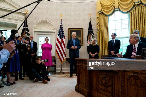 President Donald Trump participates in a signing ceremony for H.R.266, the Paycheck Protection Program and Health Care Enhancement Act, with members...
