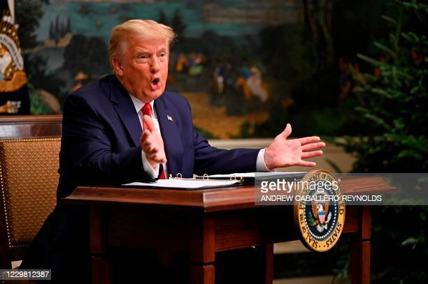 President Donald Trump participates in a Thanksgiving teleconference with members of the United States Military, at the White House in Washington,...