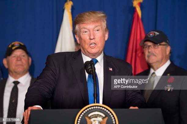 US President Donald Trump participates in a veterans meet and greet on the sidelines of the AsiaPacific Economic Cooperation leaders' summit in the...