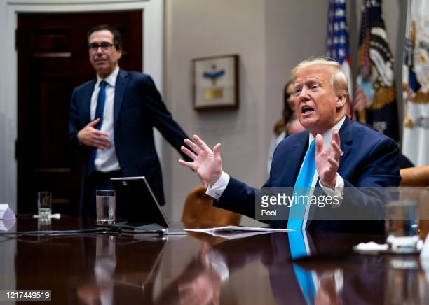 President Donald Trump participates in a video conference with representatives of large banks and credit card companies about more financial...