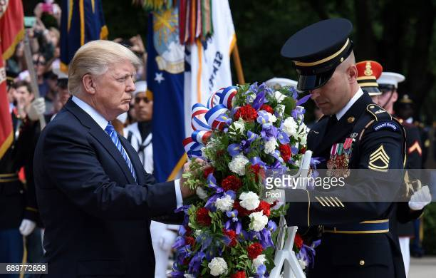 President Donald Trump participates in a wreathlaying ceremony at the Tomb of the Unknown Soldier at Arlington National Cemetery on Memorial Day May...