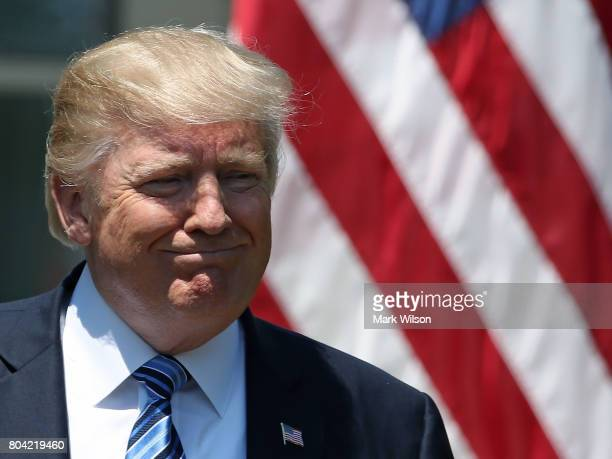 S President Donald Trump participates in delivering a joint statement with South Korean President Moon Jaein in the Rose Garden of the White House on...