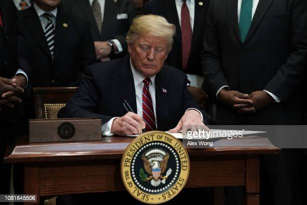 S President Donald Trump participates in signing an executive order to establish the White House Opportunity and Revitalization Council December 12...