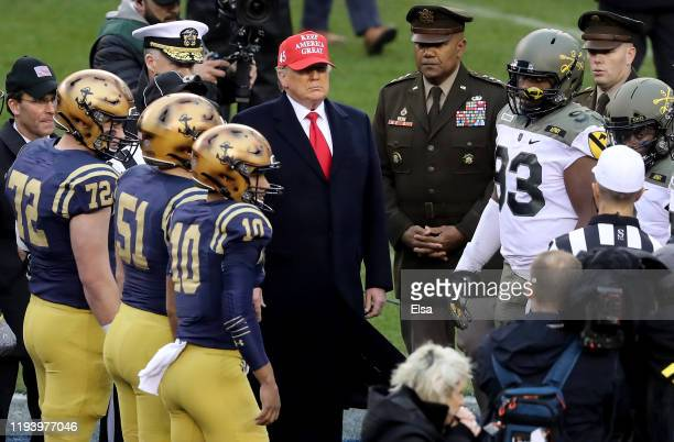 President Donald Trump participates in the coin toss before the game between the Army Black Knights and the Navy Midshipmen at Lincoln Financial...