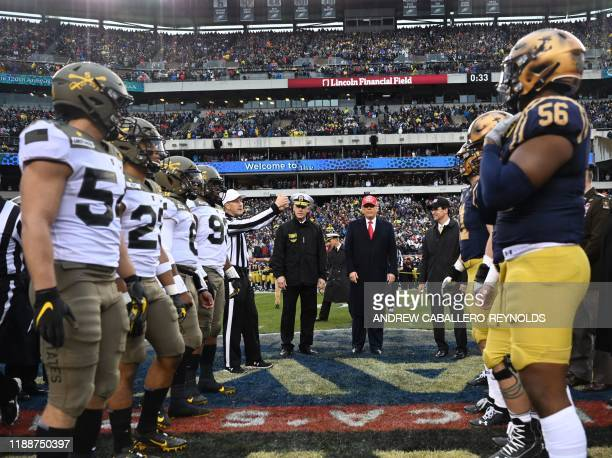 US President Donald Trump participates in the coin toss coin before the Army v Navy American Football game in Philadelphia on December 14 2019