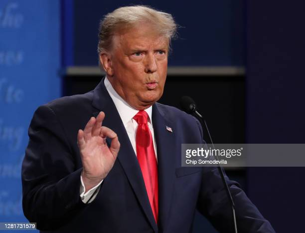 President Donald Trump participates in the final presidential debate against Democratic presidential nominee Joe Biden at Belmont University on...