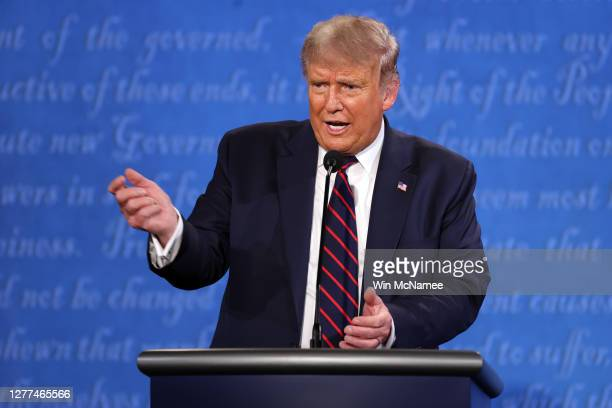 President Donald Trump participates in the first presidential debate against Democratic presidential nominee Joe Biden at the Health Education Campus...