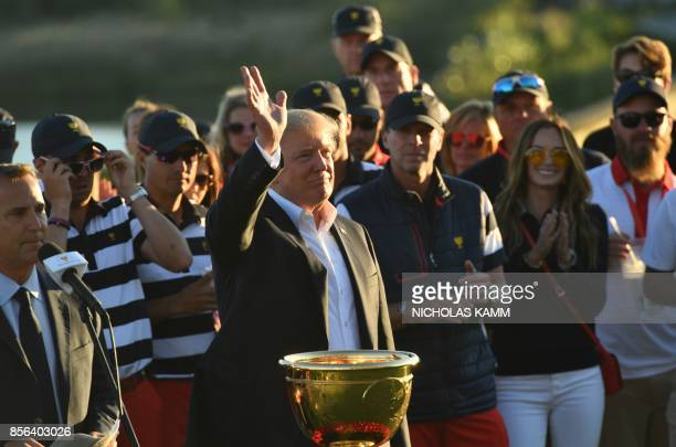 US President Donald Trump participates in the trophy presentation of the Presidents Cup golf championship at Liberty National Golf Club in Jersey...