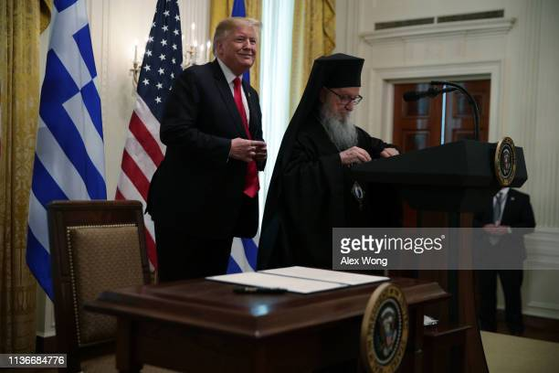 US President Donald Trump participates with Archbishop Demetrios Geron of America in a Greek Independence Day celebration at the East Room of the...