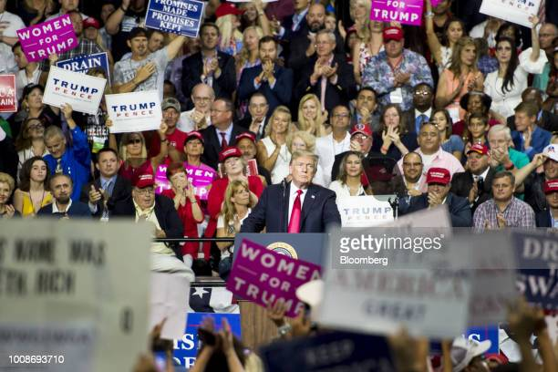 US President Donald Trump pauses as attendees applaud during a rally in Tampa Florida US on Tuesday July 31 2018 Iranian Foreign Minister Javad Zarif...