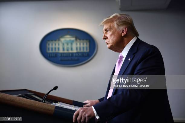 President Donald Trump pauses as he speaks during a press briefing in the James S. Brady Press Briefing Room at the White House, in Washington, DC on...