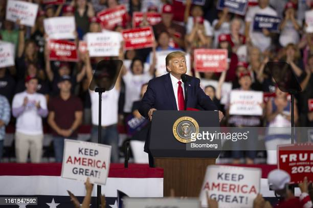 US President Donald Trump pauses as he speaks during a rally in Manchester New Hampshire US on Thursday Aug 15 2019 Trump arrived for a rally in...