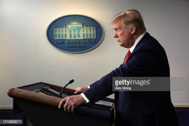 President Donald Trump pauses during a news briefing on the latest development of the coronavirus outbreak in the U.S. At the James Brady Press...