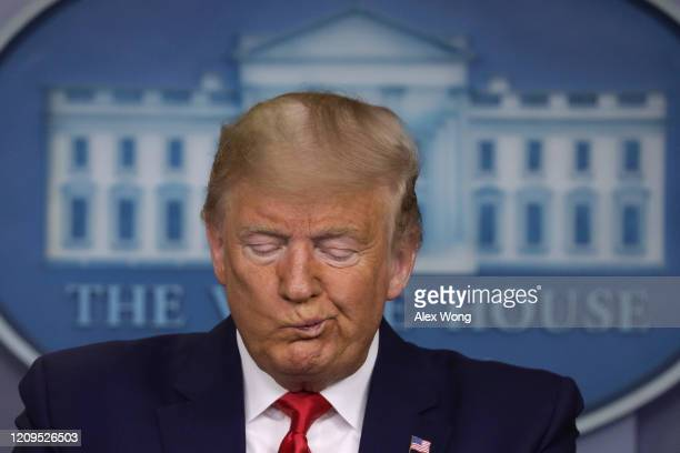 President Donald Trump pauses during a news conference at the James Brady Press Briefing Room at the White House February 29, 2020 in Washington, DC....