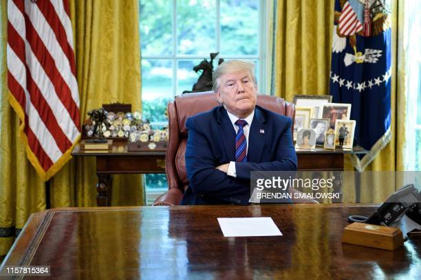 US President Donald Trump pauses while announcing an agreement with Guatemala regarding people seeking asylum in the Oval Office of the White House...