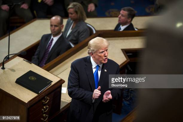 US President Donald Trump pauses while delivering a State of the Union address to a joint session of Congress at the US Capitol in Washington DC US...