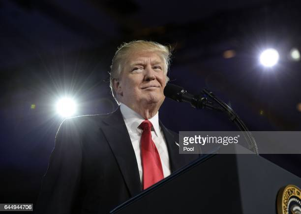 US President Donald Trump pauses while delivering remarks to the Conservative Political Action Conference on February 24 2017 in National Harbor...