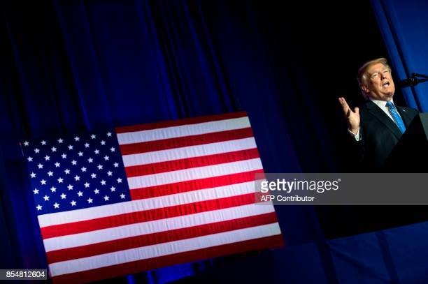 US President Donald Trump pauses while speaking about tax reform at the Indiana Farm Bureau building on the Indiana State Fairgrounds September 27...