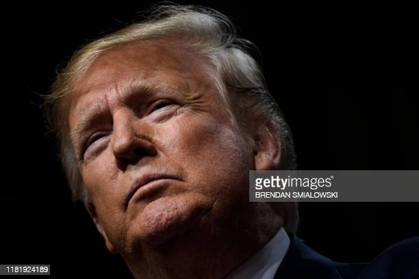 US President Donald Trump pauses while speaking at the Economic Club of New York at the New York Hilton Midtown November 12 in New York New York...