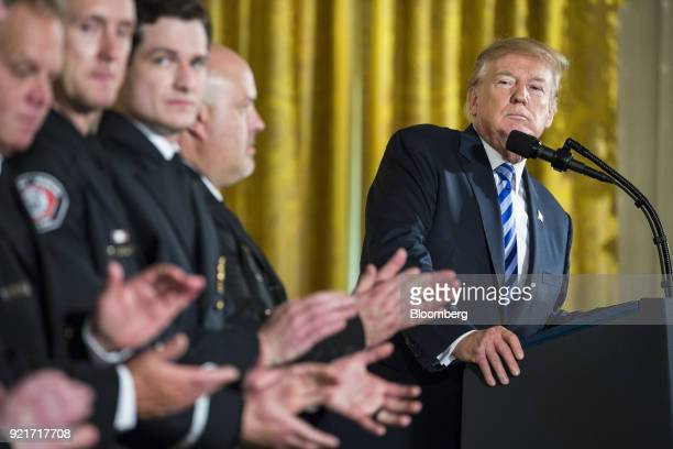 US President Donald Trump pauses while speaking during a Public Safety Medal of Valor awards ceremony in the East Room of the White House in...