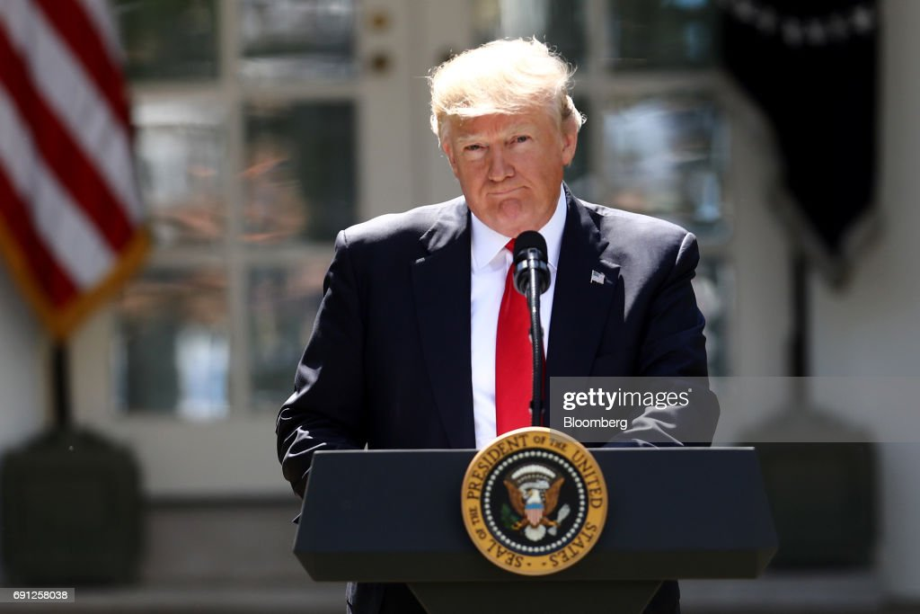 U.S. President Donald Trump pauses while speaking during an announcement in the Rose Garden of the White House in Washington, D.C., U.S., on Thursday, June 1, 2017. Trump announced the U.S. would withdraw from the Paris climate pact and that he will seek to renegotiate the international agreement in a way that treats American workers better. Photographer: Andrew Harrer/Bloomberg via Getty Images